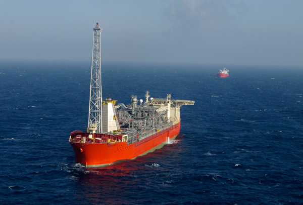 SeaRose FPSO in operation with shuttle tanker Heather Knutsen approaching in the distance