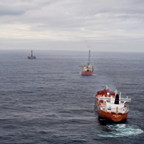 Panoramic view of the SeaRose FPSO with shuttle tanker and the drilling rigs Henry Goodrich and GSF Grand Banks in the distance