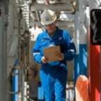 Employee inspecting natural gas equipment