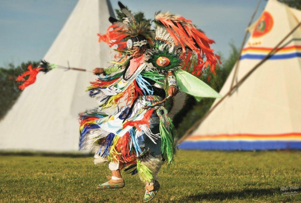 First Nations celebrate with a traditional native dance at a Pow Wow ceremony supported by Husky