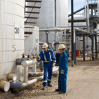 Employees inspecting gauges at the Lloydminster Asphalt Refinery