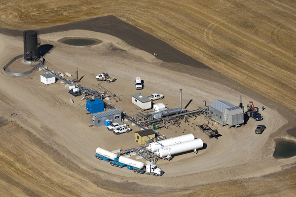 Aerial view of trucks delivering C02 to Cold Enhanced Oil Recovery (EOR) Project at Lashburn